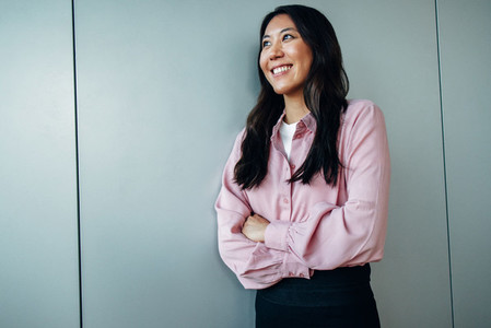 Happy businesswoman looking away and smiling