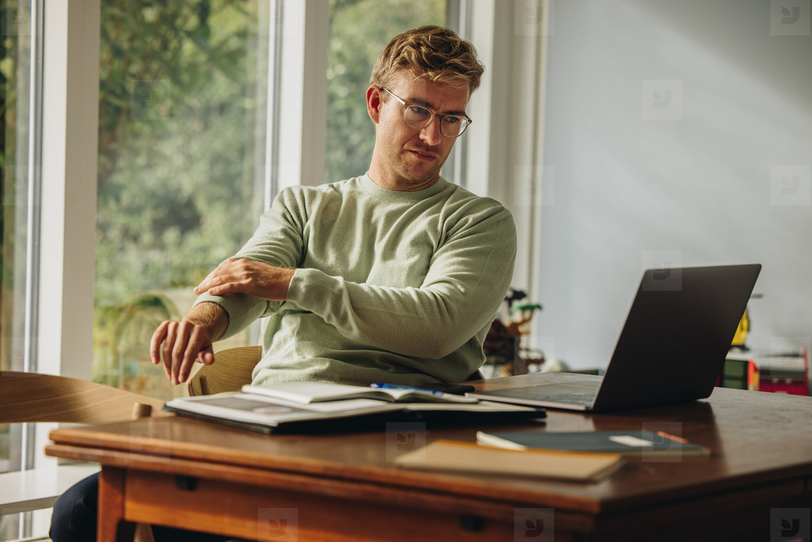 Man in casuals sitting at table