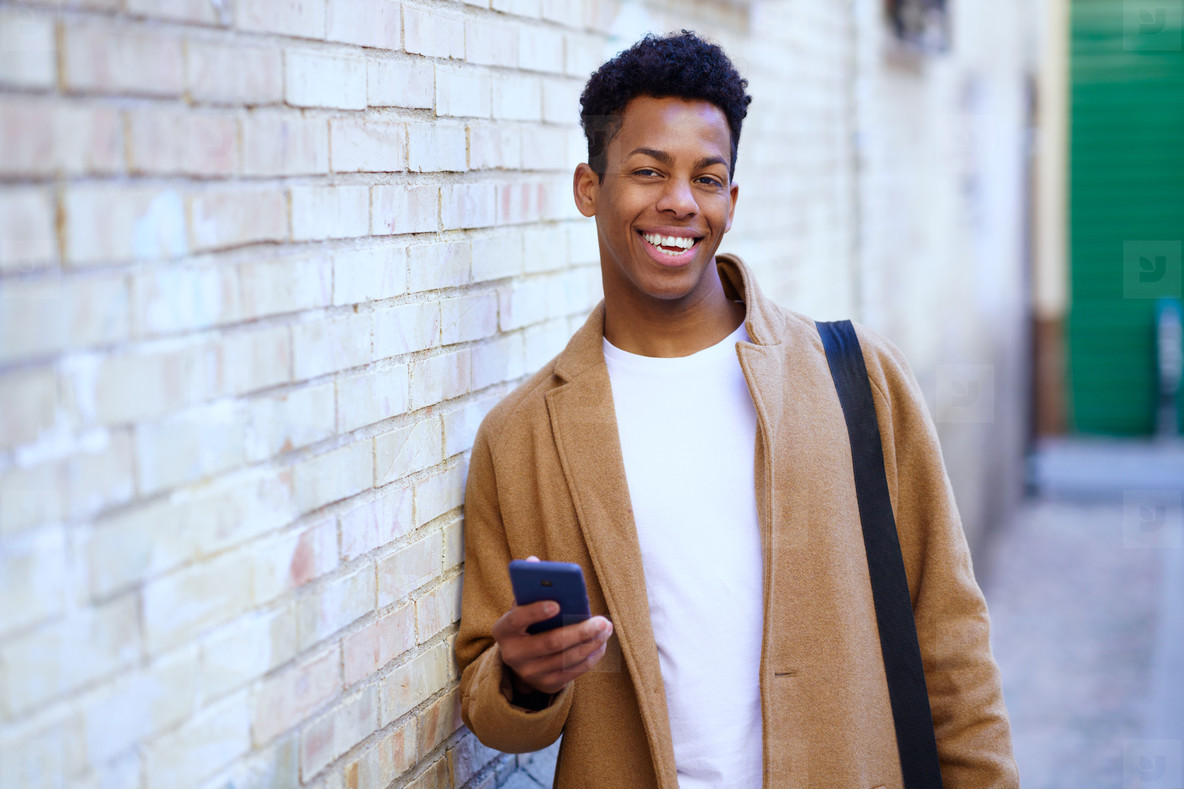 Young black man using his smartphone outdoors
