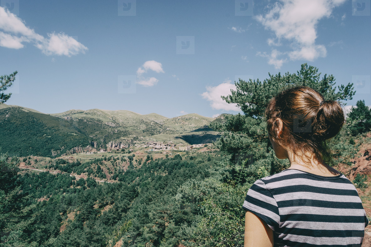 Girl walking along a small path in the mountain of Spain