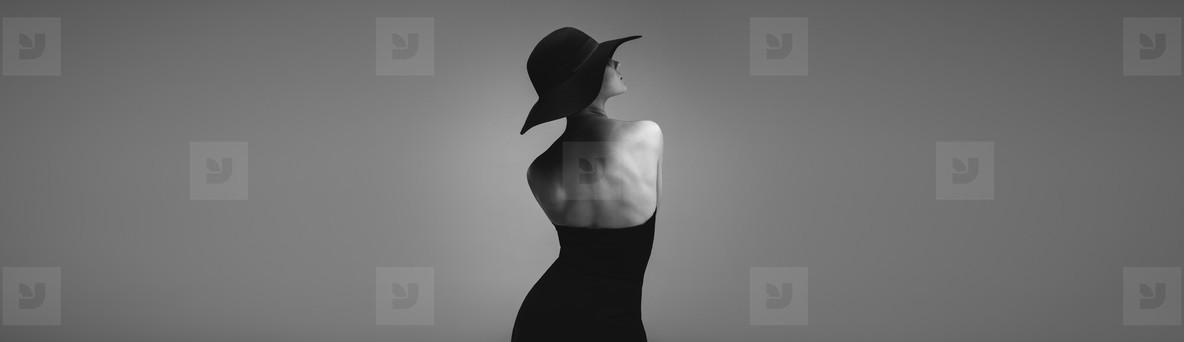 Rear view of a glamorous woman