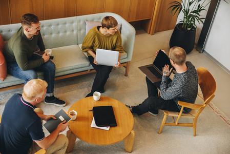 Group of business people having a brainstorming meeting