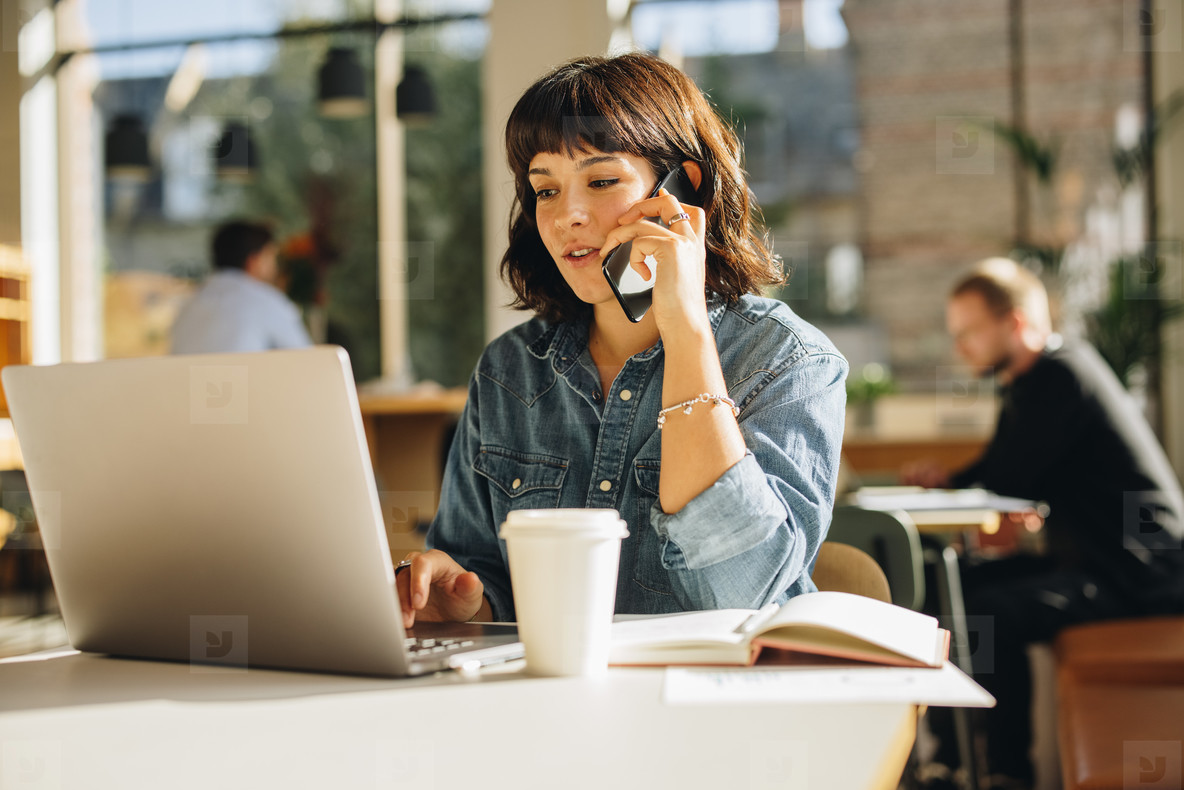 Freelancer talking with client over cell phone