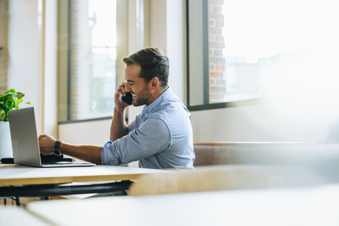 Man in office on cell phone