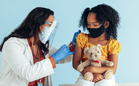 Doctor giving covid 19 vaccine to a girl