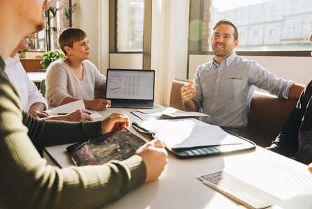Executive speaking in team meeting
