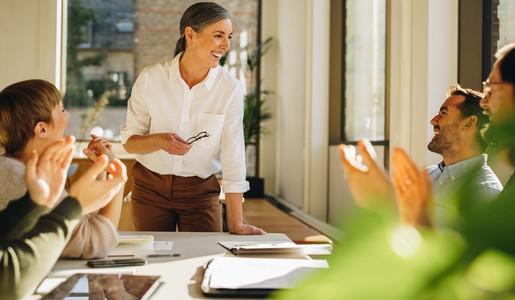 Creative team applauding in meeting