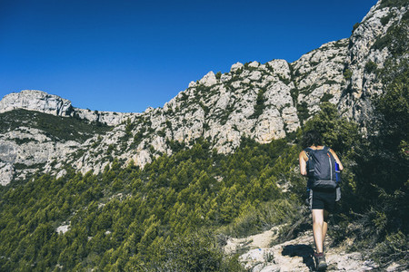 woman hiking on a mountain path in catalonia