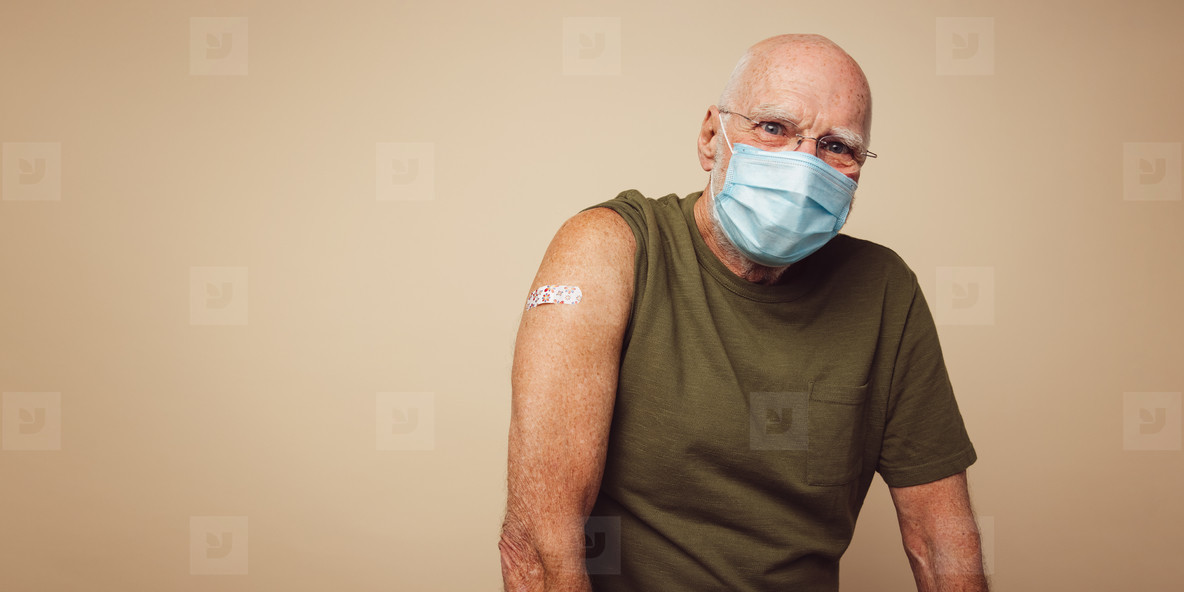 Senior man after receiving covid 19 vaccination