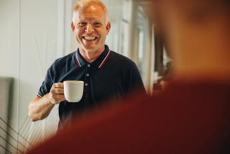 Senior businessman having coffee break