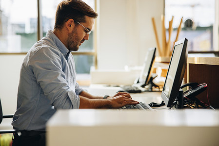 Freelancer working on computer in office