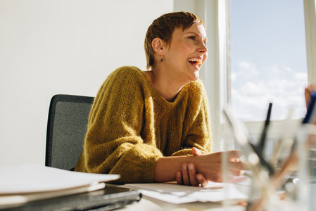 Female manager sitting at desk in office