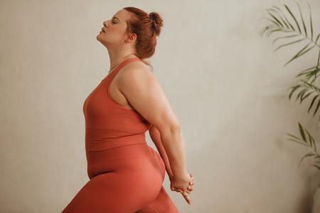 Strong woman exercising at home