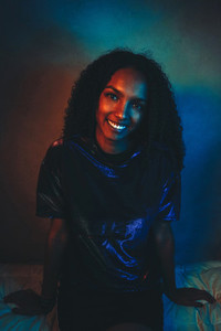 Artistic portrait with color lights of a young woman