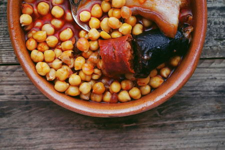 Flat of chickpeas  sausage and bacon in a crockpot  Typical food
