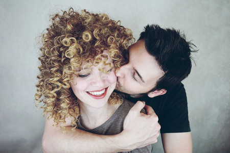 Portrait of a natural caucasian couple of young woman with curly