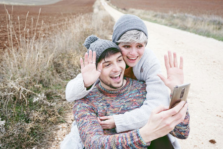 Young couple doing a video call