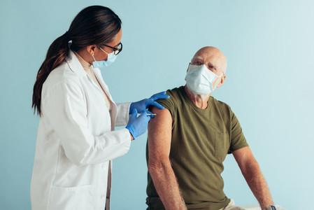 Senior man getting covid immunity vaccine