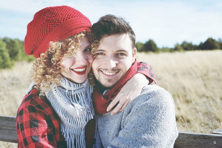 Romantic young couple of lovers look at the camera while smiling