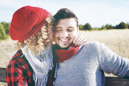 Romantic young couple of a beautiful blonde woman with curly hai
