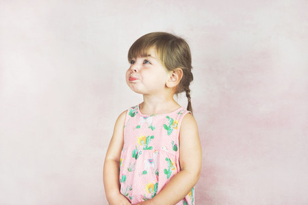 Young little and funny girl in a studio shot