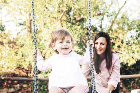 Mom and daughter having fun together in a park