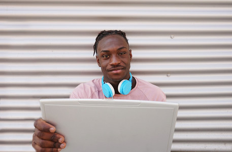 Young man working with his laptop