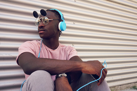 Young man listening to music with his smartphone