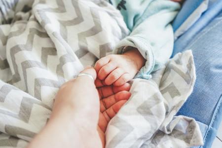 Little hand of a newborn baby