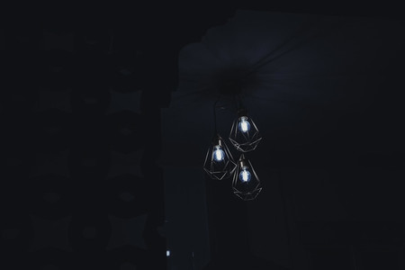 Low key image of a electric lamp during night