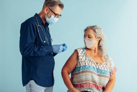 Senior woman getting corona virus vaccine