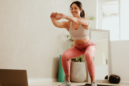Woman doing stretching workout at home