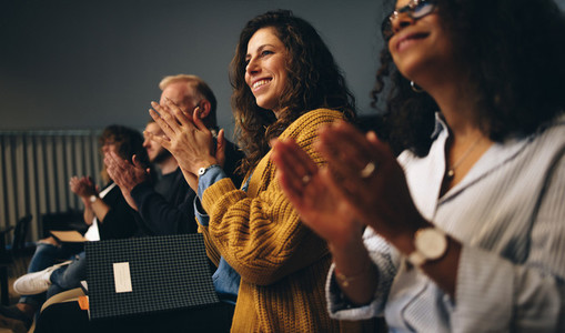 Business professionals applauding at a seminar