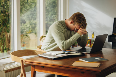Man feeling stressed while work