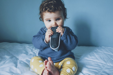 Little baby playing with a sneaker