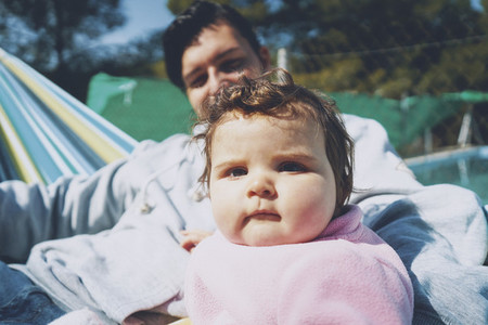 Little baby enjoying a sunny day in holidays with dad