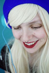 Beautiful blonde woman listening to music