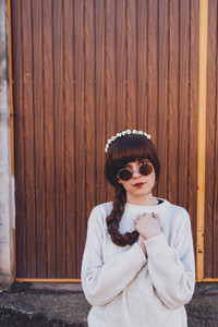 Young brunette woman with retro and hippy style