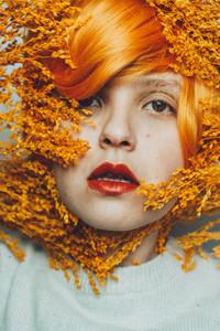 Moody portrait in orange tones of a white woman