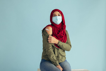 Vaccinated woman in face mask