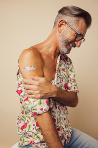 Mature man after getting covid 19 vaccine