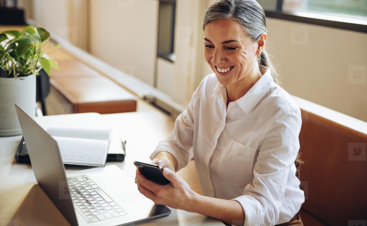 Mature businesswoman using mobile phone