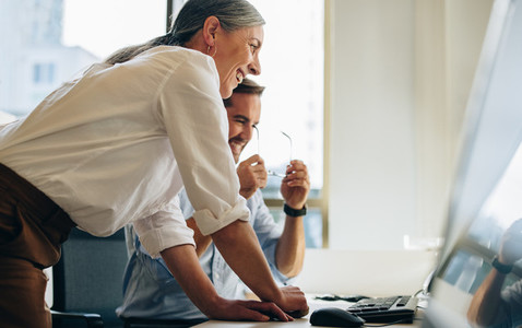 Business people working together in computer