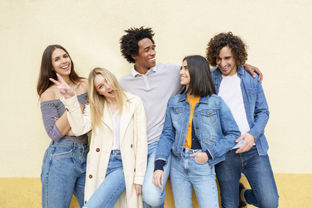 Multi ethnic group of friends posing while having fun and laughing together