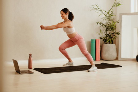 Fitness instructor teaching online class from studio