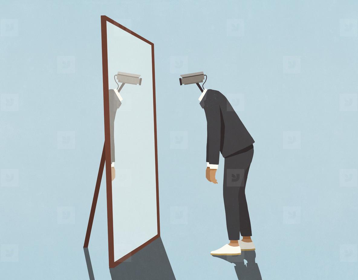 Man with surveillance camera face looking into mirror