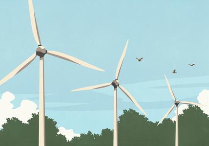 Birds flying above wind turbines