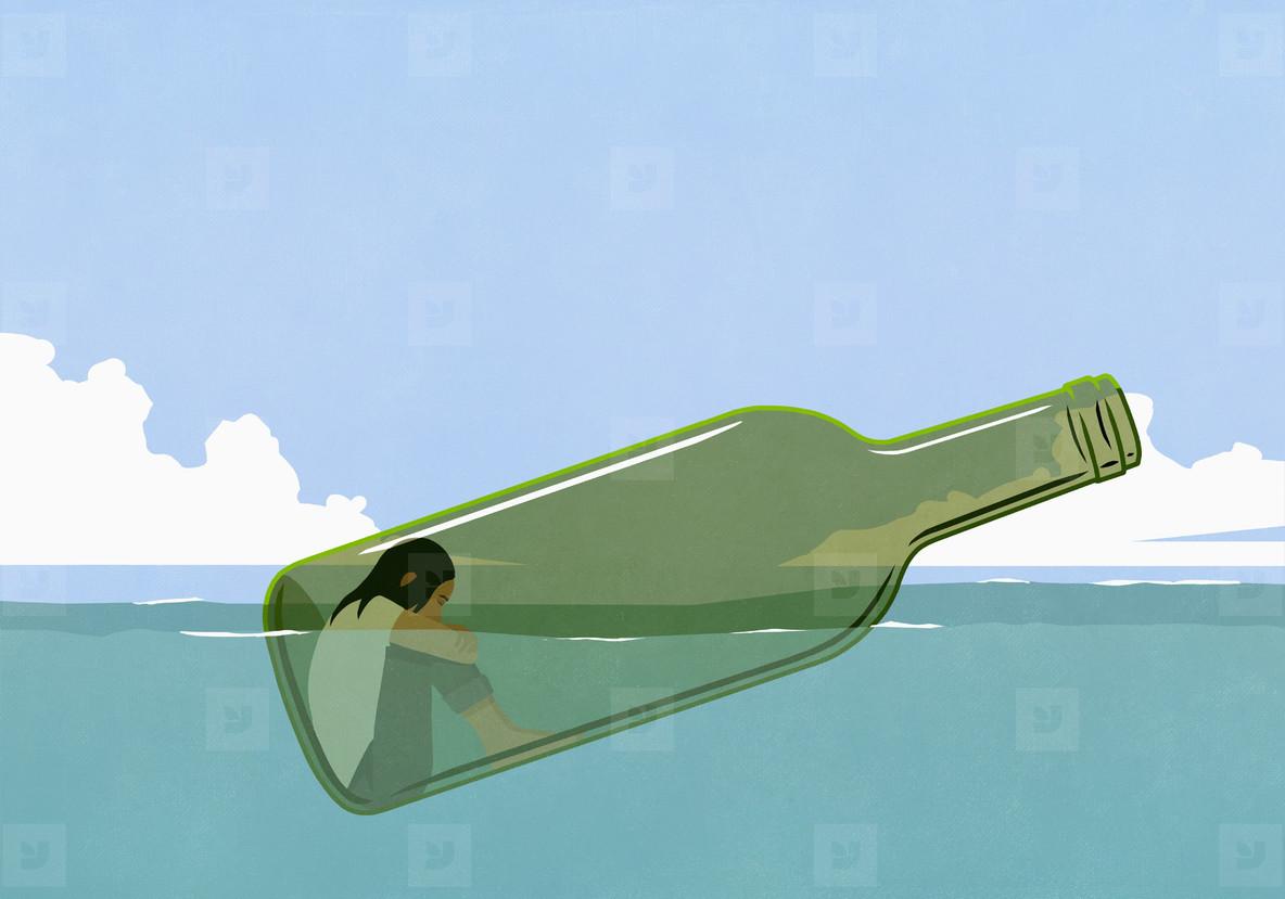 Depressed woman inside glass bottle floating in sea