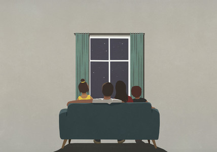 Family on sofa looking out window at starry night sky