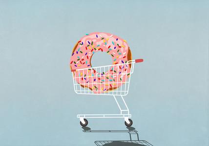 Large sprinkled donut in shopping cart